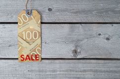 Canadian sale tag on brown vintage paper Stock Images