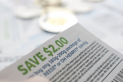 Canadian saving coupons with money. Focus on two dollar saving coupon Royalty Free Stock Photography
