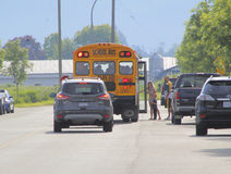 Canadian School Bus, Parents and Small Child Royalty Free Stock Photography