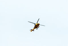 Canadian search and rescue helicopter passes overhead. Stock Images