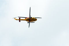 Canadian search and rescue helicopter passes overhead. Royalty Free Stock Photos