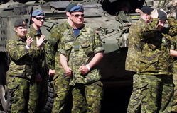 Canadian Soldiers Beside Tank Royalty Free Stock Photography