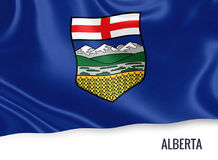 Canadian state Alberta flag. Canadian state Alberta flag waving on an isolated white background. State name is included below the flag. 3D rendering Royalty Free Stock Photography