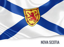 Canadian state Nova Scotia flag. Canadian state Nova Scotia flag waving on an isolated white background. State name is included below the flag. 3D rendering Royalty Free Stock Photo