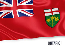 Canadian state Ontario flag. Canadian state Ontario flag waving on an isolated white background. State name is included below the flag. 3D rendering Stock Photos