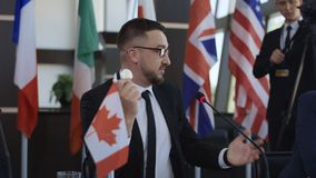 Canadian statesman giving speech of cryptocurrency. Formal representation of Canada standing on tribune and delivering speech about cryptocurrency of bitcoin on stock footage