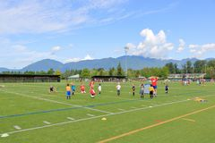 Canadian Summer Soccer Camp for Children. Boys watch and listen to instructors during summer soccer camp  held at the Townsend Park in Chilliwack, BC, Canada on royalty free stock photo
