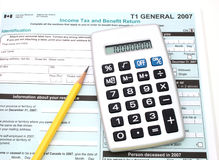 Canadian taxes. Calculator and pencil over a  canadian general tax return form Stock Photo