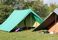 Canadian tents set up in a boy scout camp. Two Canadian tents set up in a boy scout camp Stock Photos