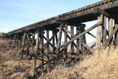 Canadian Train Trestle. A Canadian train trestle made of oil soaked beams Royalty Free Stock Photography