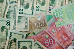 Canadian and USA currency dollars of denomination 20,50 and 100 Royalty Free Stock Image