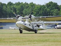Canadian Vickers PBY-5A Canso Catalina amphibian aircraft in Goraszka in Poland. Take-off from grass runway during Goraszka Airsho in 2008 in Poland. other Stock Photos