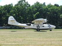 Canadian Vickers PBY-5A Canso Catalina amphibian aircraft in Goraszka in Poland. Taxiing after landing on grass runway during Goraszka Air show in 2008 in Royalty Free Stock Photography
