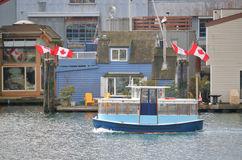 Canadian Water Taxi and Flags Stock Photography