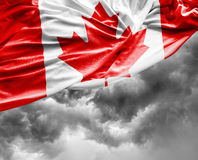 Canadian waving flag on bad day.  Royalty Free Stock Images