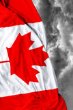 Canadian waving flag on bad day Stock Photo