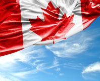 Canadian waving flag on beautiful day Stock Images