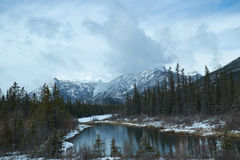 Canadian winter landscape. With the Rockies and a lake with reflections royalty free stock image