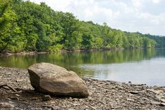 Canadice Lake. Rock on the shore of Canadice Lake, one of the Finger Lakes, New York State Stock Photo