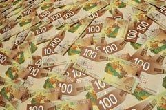 Canadiense cientos cuentas de dólar Fotos de archivo