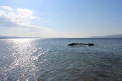 Sea and calm skies Stock Image
