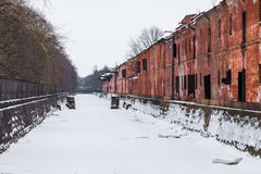 Canal and abandoned building in winter scene Royalty Free Stock Photos