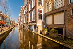 Canal along Voldersgracht street, in the old center of Delft Stock Image