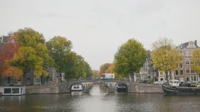 Canal in Amsterdam, Amstel river, Holland, Netherlands stock footage