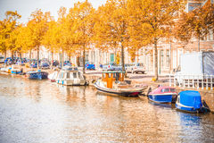 Canal in Amsterdam during the autumn Stock Photos
