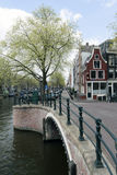 Canal in amsterdam with bridge, prinsengracht, reguliersgracht Royalty Free Stock Photos