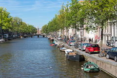 Canal in Amsterdam with historic mansions Stock Photo