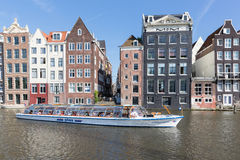 Canal in Amsterdam with historic mansions Royalty Free Stock Images