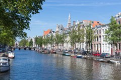 Canal in Amsterdam with historic mansions Royalty Free Stock Image