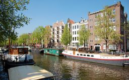 Canal of Amsterdam, houses boats Royalty Free Stock Images