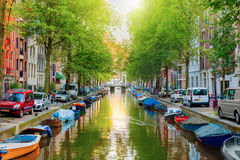 Canal in Amsterdam. Canal houses in Amsterdam, Netherlands royalty free stock images
