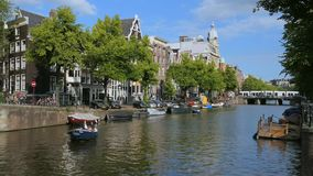 Canal in Amsterdam, Netherlands. Keizersgracht Canal with boats and historic houses, Amsterdam, Holland, Netherlands, Europe stock footage