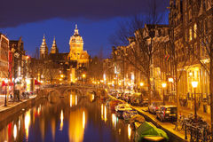 Canal in Amsterdam, The Netherlands by night Royalty Free Stock Photo
