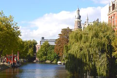 Canal in Amsterdam. Weeping Willow Tree along canal in Netherlands Stock Photo