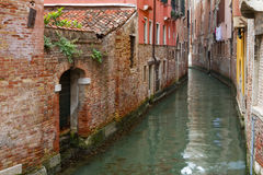Narrow canal in Venice. Stock Images