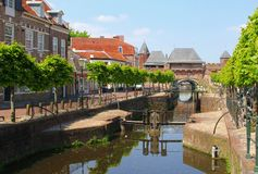 Canal and ancient fortress wall Koppelpoort,Amersfoort,Holland. Canal along the Grote Spui and Kleine Spui and ancient fortress wall (called the Koppelpoort) in royalty free stock image