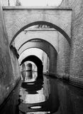 Canal with arches Stock Images