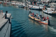 Canal Avairo Man on the verge watching gondola stock image