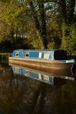 Canal barge narrow boat in water surrounded by trees Royalty Free Stock Photography