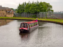 Canal barge negotiating the locks. On the Leeds Liverpool Canal.Lancashire, UK Stock Photography