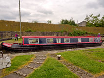 Canal barge negotiating the locks Stock Photo