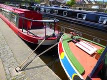 Narrowboats moored in a canal basin Royalty Free Stock Photos