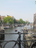 Canal and Bike in Amsterdam Stock Photo