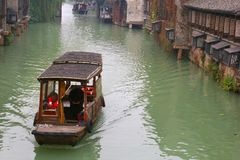 Canal boat in a water lane in the ancient water town Wuzhen (Unesco), China Royalty Free Stock Photos