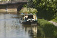 Canal boat Britain. Canal boat moored at a quiet location in rural England royalty free stock images