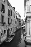 Canal with boat and buildings in Venice. Stock Images